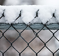 [Snow-topped fence] - snow, wet snow, chain link fence, bokeh